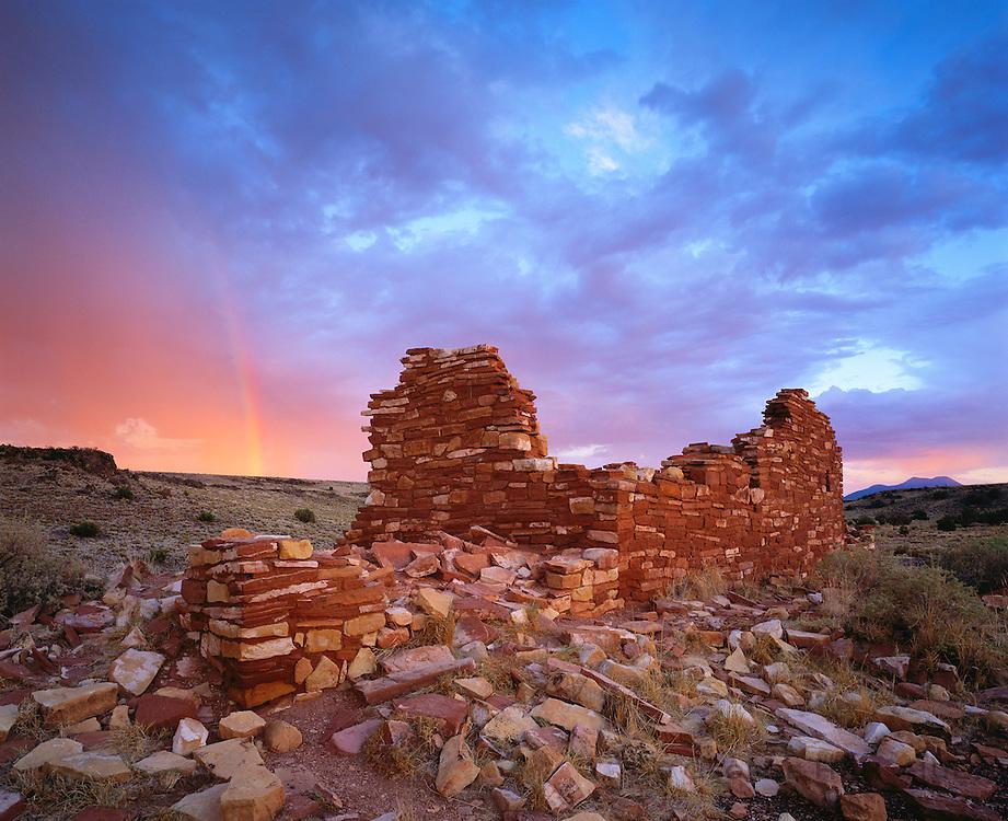 0121-1023LVT ~ Copyright: George H. H. Huey ~ Box Canyon ruins with summer storm and rainbow at sunset. [Kayenta Anasazi culture].  Wupatki National Monument, Arizona.