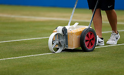 Head groundsman Graham Kimpton paints the lines on Centre Court before the final during day seven of the 2017 AEGON Championships at The Queen's Club, London. PRESS ASSOCIATION Photo. Picture date: Sunday June 25, 2017. See PA story TENNIS Queens. Photo credit should read: Steven Paston/PA Wire. RESTRICTIONS: Editorial use only, no commercial use without prior permission.