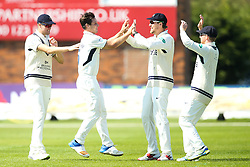 Hilton Cartwright of Middlesex celebrates with teammates after taking the wicket of Alex Hughes of Derbyshire - Mandatory by-line: Robbie Stephenson/JMP - 20/04/2018 - CRICKET - The 3aaa County Ground  - Derby, England - Derbyshire CCC v Middlesex CCC - Specsavers County Championship Division Two
