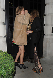 Cara Delevingne and Georgia May Jagger at Poppy Delevingne's hen party at the Groucho club in Soho, London, UK. 30/11/2013 <br />