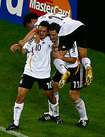 Dortmund 14/6/2006 World Cup 2006<br /> <br /> Germany Poland - Germania Polonia 1-0<br /> <br /> Photo Andrea Staccioli Graffitipress<br /> <br /> Oliver Neuville celebrates after scoring with Miroslav Klose and Michael Ballack<br /> <br /> Oliver Neuville festeggia con Miroslav Klose e Michael Ballack dopo aver segnato il gol della vittoria per la Germania