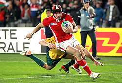 © SPORTZPICS/ Seconds Left Images 2011 -  Wales' Leigh Halfpenny beats Australia's Adam Ashley-Cooper &  dives over to score a try at the death Wales v Australia - Rugby World Cup 2011 - Bronze Final - Eden Park - Auckland - New Zealand - 21/10/2011 -  All rights reserved..