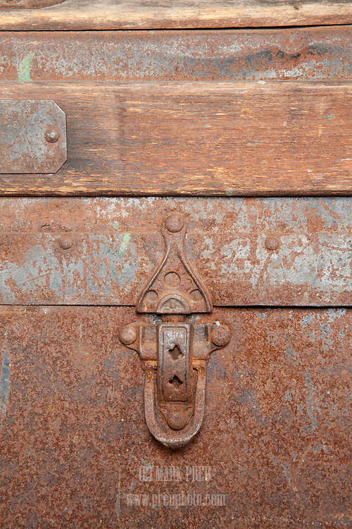 A rusted latch on a steamer trunk in the C-Scape dune shack.