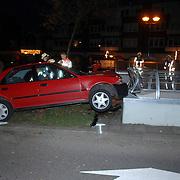 NLD/Huizen/20061201 - Ongeval Bovenmaatweg Huizen, auto tegen fietsovergang