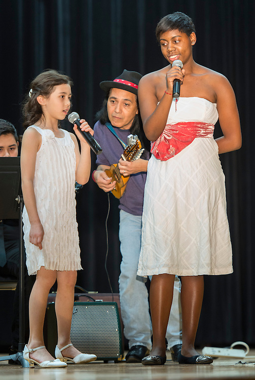 Alexandra Adams, left, of Mandarin Chinese Emersion School and Krystal Parks, right, of Sharpstown International School perform with Frank Rodriguez, center, during a district wide celebration of the Chinese New Year at Sharpstown International, February 22, 2014.