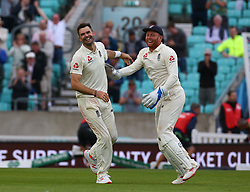 September 11, 2018 - London, Greater London, United Kingdom - James Anderson celebrates with England's Jos Buttler  and became the latest England paceman to make history at the Oval on Tuesday by setting a new record for the most wickets taken by any fast bowler in test history..during International Specsavers Test Series 5th Test match Day Five  between England and India at Kia Oval  Ground, London, England on 11 Sept 2018. (Credit Image: © Action Foto Sport/NurPhoto/ZUMA Press)