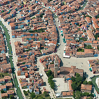VENICE, ITALY - JULY 07:   A detailed aerial view of the Island of Burano with its coloured houses seen during the Seawing  tour above Venice on July 7, 2011 in Venice, Italy. Seawings has started a new tour of Venice by seaplane, offering aerial views of the Venetian Lagoon and its historic islands, continuing a long history of seaplanes in Venice.