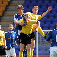 St Johnstone v Queen of the South...14.08.04<br />Ian Maxwell in aerial tussle with gary Wood and Brian McColligan<br /><br />Picture by Graeme Hart.<br />Copyright Perthshire Picture Agency<br />Tel: 01738 623350  Mobile: 07990 594431