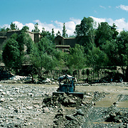 21 May 1976 <br /> Bulldozer pushing gravel closer. Houses of north section in background.