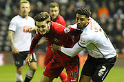 Blackburn Rovers midfielder Matt Grimes and Derby County defender Cyrus Christie battle it out for possession during the Sky Bet Championship match between Derby County and Blackburn Rovers at the iPro Stadium, Derby, England on 24 February 2016. Photo by Aaron  Lupton.