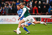 Hibernian FC Forward Jason Cummings plays the ball forward during the Scottish League Cup semi-final match between Hibernian and St Johnstone at Tynecastle Stadium, Gorgie, Scotland on 30 January 2016. Photo by Craig McAllister.
