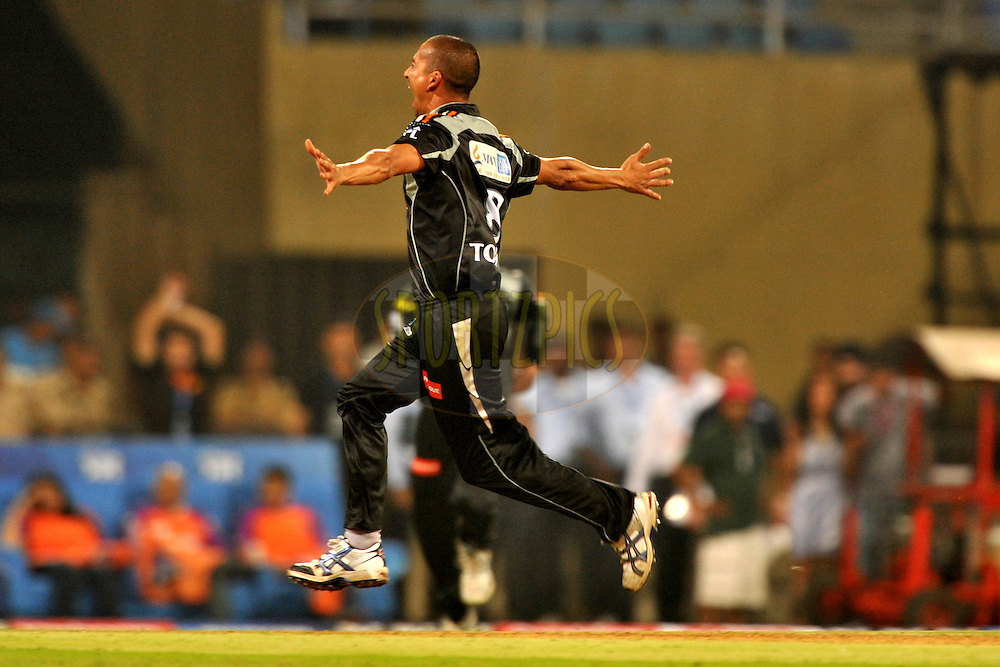 Alfonso Thomas of Pune Warriors India celebrate the wicket of Brendon McCullum of Kochi Tuskers Kerala  during  match 10 of the Indian Premier League ( IPL ) Season 4 between the Pune Warriors and the Kochi Tuskers Kerala held at the Dr DY Patil Sports Academy, Mumbai India on the 12th April 2011..Photo by Pal Pillai /BCCI/SPORTZPICS