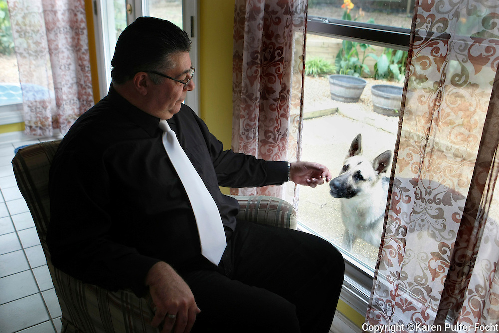 Alonso Esposito, a former Boston mobster-turned pastor, with his dog, in his Memphis home on Monday, June 27th, 2016.