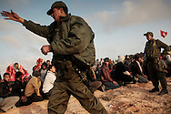 After walking from Libya, thousand of Bengladesh migrant workers are welcomed by Tunisian militaries at a transit camp in Choucha, 7 km from Tunisia's Ras Jdir border station.  28 February 2011.