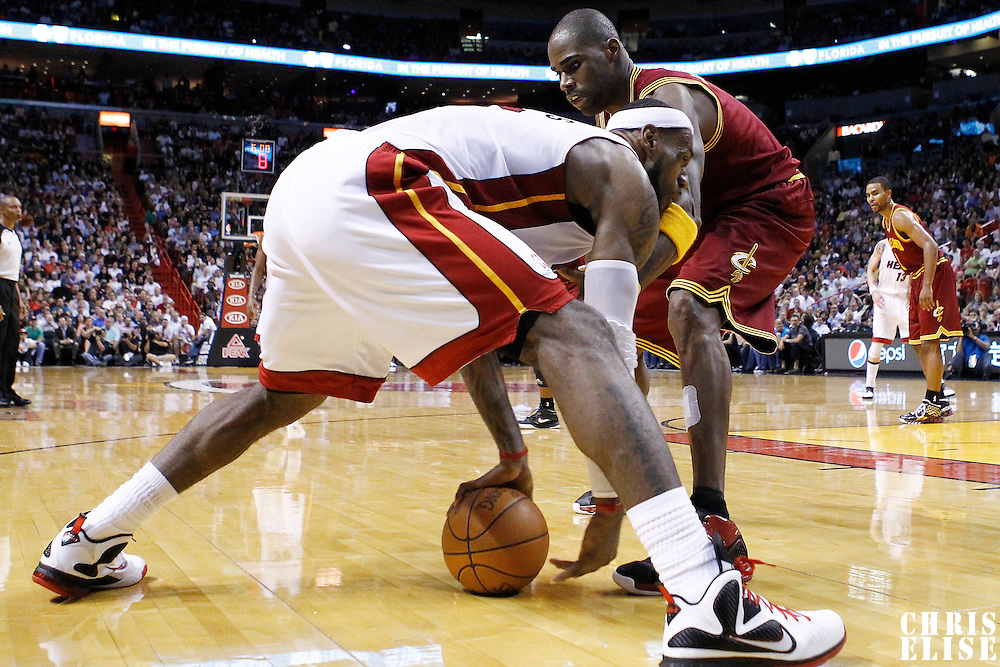 24 January 2012: Cleveland Cavaliers power forward Antawn Jamison (4) defends on Miami Heat small forward LeBron James (6) during the Miami Heat 92-85 victory over the Cleveland Cavaliers at the AmericanAirlines Arena, Miami, Florida, USA.