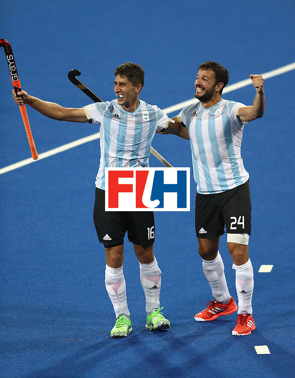 RIO DE JANEIRO, BRAZIL - AUGUST 18: Ignacio Ortiz (L) and Manuel Brunet of Argentina celebrate their 4-2 victory to win the gold medal during the Men's Gold Medal match between Argentina and Belgium on Day 13 of the Rio 2016 Olympic Games held at the Olympic Hockey Centre on August 18, 2016 in Rio de Janeiro, Brazil.  (Photo by David Rogers/Getty Images)