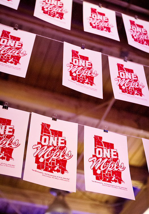 "Screen prints for the ""One Minneapolis"" campaign hang to dry during Minneapolis Mayor Betsy Hodges' inauguration party at the historic Thorp Building in Northeast Minneapolis, Saturday, January 11, 2014."
