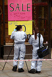 © under license to London News Pictures.  13/01/2011. Forensics examine writing on a sign in the window of an Accessorize store London's Regent Street, after a man was arrested after he broke into a shop in London's Regent Street and threatened to blow himself up.  Photo credit should read London News Pictures..