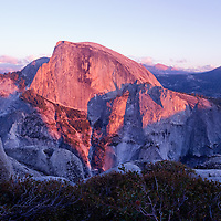 After the grueling hike up the Yosemite Falls trail and over to North Dome we arrived just as the sun was letting go it's brilliant light on the famous face of Half Dome. There was less than 5 minutes of alpenglow on half dome, then twilight and all went dark. We still had another 8 miles to go. Yosemite is such an amazing place. Thanks for looking.