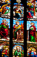 Milan, Italy, Duomo Cathedral. Stained glass window. Panes depicting various saints.