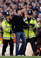 Photo: Daniel Hambury.<br />Arsenal v Cardiff City. The FA Cup. 07/01/2006.<br />A Cardiff fan is escorted out of the game. This is NOT the fan who entered the pitch.