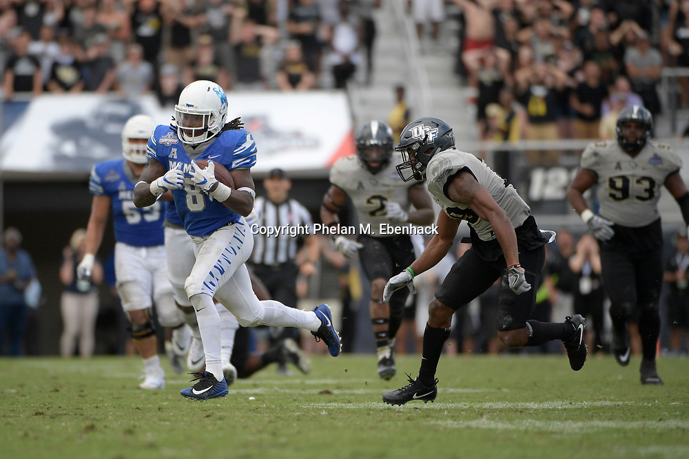 Memphis running back Darrell Henderson (8) rushes for yardage in front of Central Florida defensive back Mike Hughes (19) during the second half of the American Athletic Conference championship NCAA college football game Saturday, Dec. 2, 2017, in Orlando, Fla. Central Florida won 62-55. (Photo by Phelan M. Ebenhack)