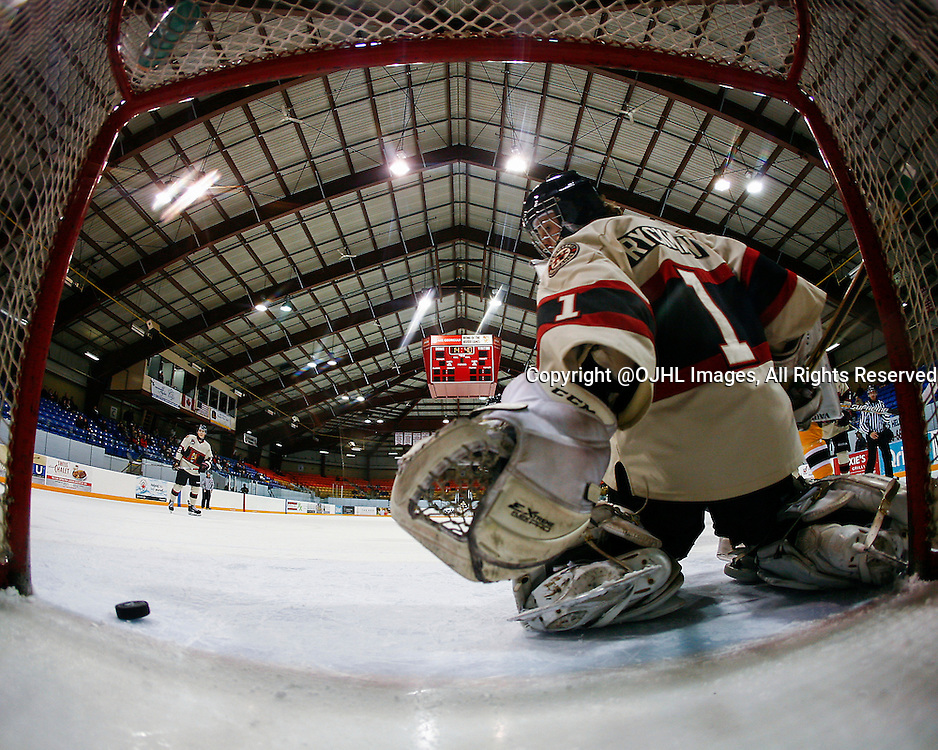 AURORA, ON - Mar 4, 2015 : Ontario Junior Hockey League game action between the Aurora Tigers and the Newmarket Hurricanes.  Game four of the best of seven series,  Connor Ryckman #1 keeps an eye on the puck in the first period.<br /> (Photo by Brian Watts / OJHL Images)