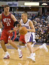 November 27, 2009; Sacramento, CA, USA;  Sacramento Kings guard Sergio Rodriguez (10) dribbles past New Jersey Nets center Brook Lopez (11) during the fourth quarter at the ARCO Arena. Sacramento defeated New Jersey 109-96.