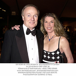 SIR ROBIN & LADY RENWICK  at a reception in London on 22nd March 2001.			OML 56