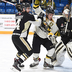 "TRENTON, ON  - MAY 2,  2017: Canadian Junior Hockey League, Central Canadian Jr. ""A"" Championship. The Dudley Hewitt Cup. Game 2 between Powassan Voodoos and the Trenton Golden Hawks. Chays Ruddy #4 of the Trenton Golden Hawks battles for control with Gary Mantz #9 of the Powassan Voodoos during the first period.<br /> (Photo by Andy Corneau / OJHL Images)"