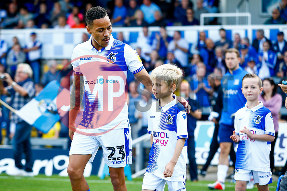 Child match mascots walk out with the team, pictured Kyle Bennett of Bristol Rovers with mascot - Mandatory by-line: Ryan Hiscott/JMP - 25/08/2018 - FOOTBALL - Memorial Stadium - Bristol, England - Bristol Rovers v Southend United - Sky Bet League One