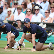 LONDON, ENGLAND - JULY 13: Ball boys in action on Center Court during the Wimbledon Lawn Tennis Championships at the All England Lawn Tennis and Croquet Club at Wimbledon on July 13, 2017 in London, England. (Photo by Tim Clayton/Corbis via Getty Images)