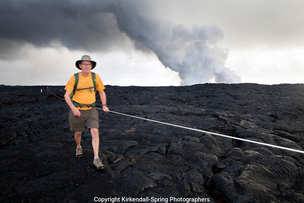 HI00290-00...HAWAI'I - Hiker, Greg Vaughn,  walking across the Pu'u O'o lava field in Hawai'i Volcanoes National Park on the island of Hawai'i. (MR# V-2)