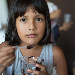 Villager Mariel Vasquez Salazar samples chocolate manufactured at local chocolate factory, Amazonico, in St. Ignatio.