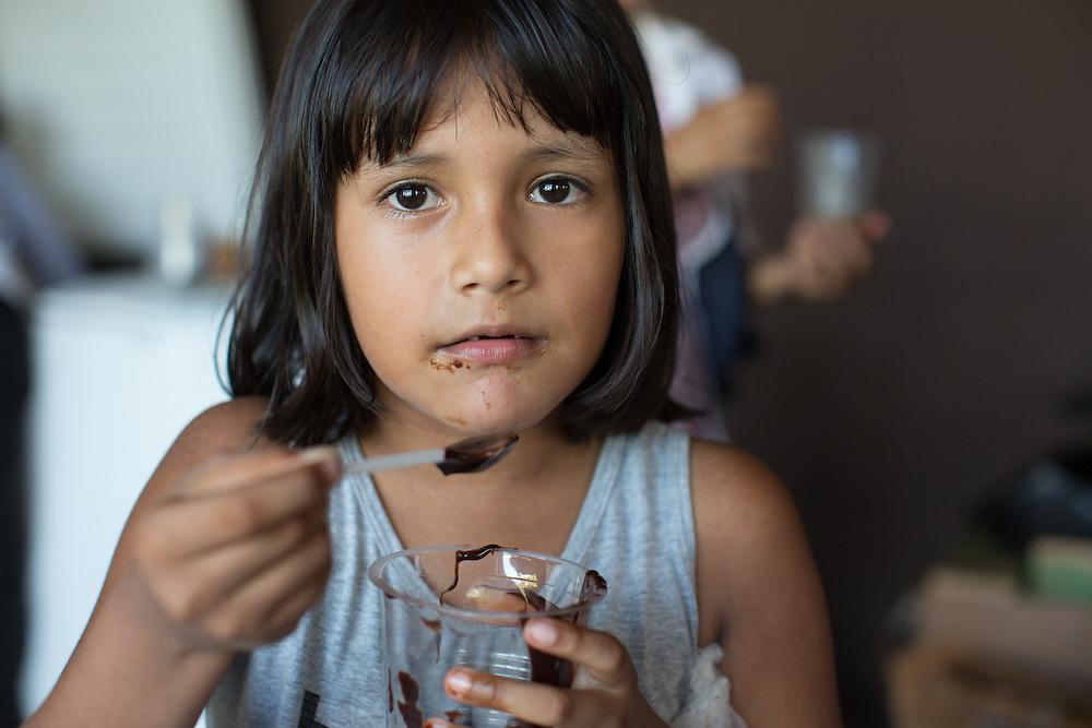 Villager Mariel Vasquez Salazar samples chocolate manufactured at local chocolate factory, Amazonico, in St. Ignatio.
