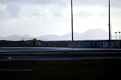 UNITED KINGDOM WALES ANGLESEY 18NOV10 - An unidentified crew member is seen leaving an RAF Sea King Search and Rescue helicopter  in Anglesey, north Wales where Prince William serves as an RAF Search and Rescue helicopter pilot...jre/Photo by Jiri Rezac..© Jiri Rezac 2010