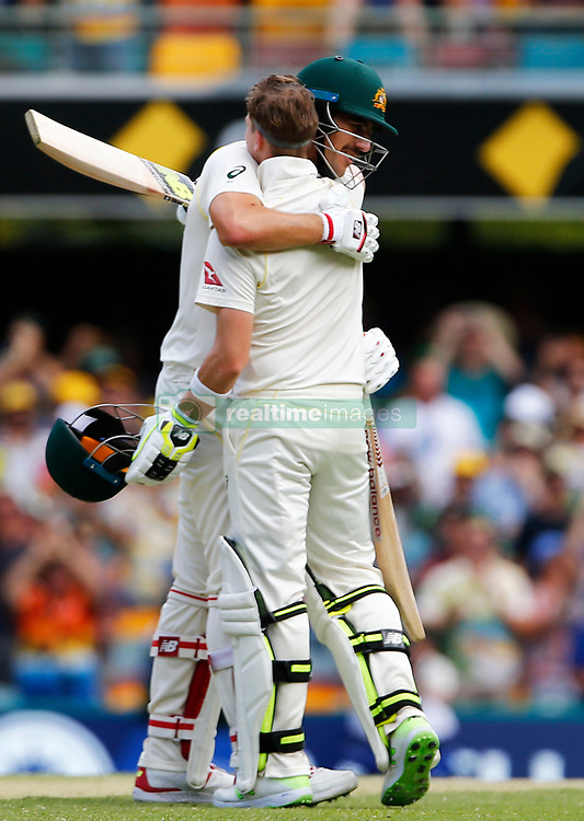 Australia's Steve Smith celebrates his century with Pat Cummins during day three of the Ashes Test match at The Gabba, Brisbane.