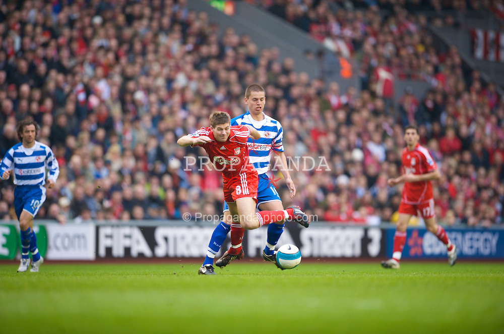 LIVERPOOL, ENGLAND - Saturday, March 15, 2008: Liverpool's captain Steven Gerrard MBE is brought down by Reading's Ivar Ingimarsson during the Premiership match at Anfield. (Photo by David Rawcliffe/Propaganda)