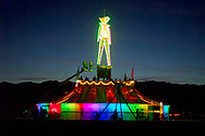 """BLACK ROCK CITY, NV:  Dusk over the fun house in Black Rock City, Nevada.  The fun house served as the pedestal for """"The Man"""" that is the centerpiece of Burning Man festival.  On the second to last night of the festival """"The Man"""" is burned while much of Black Rock City watches."""