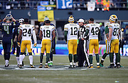 The Green Bay Packers get ready for the overtime coin toss officiated by referee Tony Corrente (99) during the NFL week 20 NFC Championship football game against the Seattle Seahawks on Sunday, Jan. 18, 2015 in Seattle. The Seahawks won the game 28-22 in overtime. ©Paul Anthony Spinelli