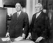 Frank B Kellogg, right, US Secretary of State 1925-1929, defending American interference in Nicaragua, 1927.