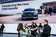 New York, NY - 12 April 2017. Hyundai's Senior Chief Designer for North America, Chris Chapman, giving an interview at the NY Auto Show. The design team is distributed and works internationally.