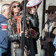 05 November 2012:  Aerosmith's Steven Tyler with a custom Patriots game ball before Aerosmiths' free concert  in Allston in front of the building (1325Commonwealth Ave) where band members once lived.  Boston, MA. ***Editorial Use Only*****
