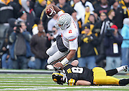 November 20 2010: Ohio State Buckeyes quarterback Terrelle Pryor (2) is tripped up by Iowa Hawkeyes cornerback Tyler Sash (9) during the second quarter of the NCAA football game between the Ohio State Buckeyes and the Iowa Hawkeyes at Kinnick Stadium in Iowa City, Iowa on Saturday November 20, 2010. Ohio State defeated Iowa 20-17.