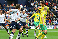 Preston - Saturday September 18th, 2010: Chris Martin of Norwich header is partly saved by Andy Lonergan of Preston but is cleared of the line by David Gray during the Npower Championship match at Deepdale, Preston. (Pic by Paul Chesterton/Focus Images)