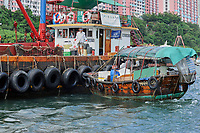 Sampan in Aberdeen fishing village, Hong Kong, Hong Kong, August 2008   Photo: Peter Llewellyn