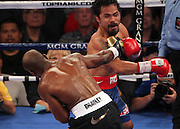 LAS VEGAS, NV - JUNE 09:  (L-R) Timothy Bradley lands a right to the head of Manny Pacquiao during their WBO welterweight title fight at MGM Grand Garden Arena on June 9, 2012 in Las Vegas, Nevada.  (Photo by Jeff Bottari/Getty Images)