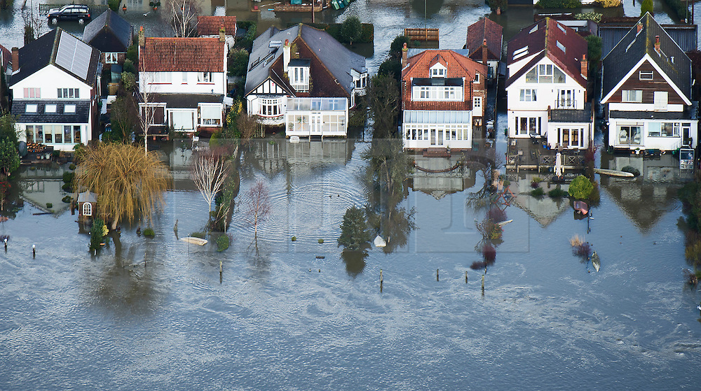 © London News Pictures. 09/02/2014. Shepperton, UK.  Aerial view showing flooding covering properties between Shepperton and Chertsey, Surrey. The Thames river has hit record levels causing extensive flooding to parts of the southeast of England. Photo credit : Ben Cawthra/LNP