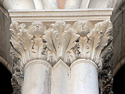 (Detail) architectural feature from the Doge's Palace in Venice, Italy. The palace was the residence of the Doge of Venice, the supreme authority of the Republic of Venice. Its two most visible façades look towards the Venetian Lagoon and St. Mark's Square, or rather the Piazzetta. The use of arcading in the lower stories produces an interesting 'gravity-defying' effect. There is also effective use of colour contrasts. largely constructed from 1309 to 1424, designed perhaps by Filippo Calendario. It replaced earlier fortified buildings of which relatively little is known. Giovanni and Bartolomeo Bon created the Porta della Carta in 1442, a monumental late-gothic gate on the Piazzetta side of the palace. This gate leads to a central courtyard. The palace was badly damaged by a fire on December 20, 1577.