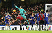 Chelsea goalkeeper Thibaut Courtois coming and missing a punch during the Barclays Premier League match between Chelsea and West Bromwich Albion at Stamford Bridge, London, England on 13 January 2016. Photo by Matthew Redman.
